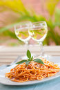 Spaghetti with tomato sauce and two glasses of win Stock Images