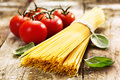 Spaghetti and tomatoes Stock Images