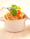 Spaghetti with tomatoes and basil in an earthenware pot Stock Photography