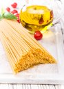 Spaghetti with tomatoes on wooden table Royalty Free Stock Image