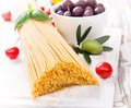 Spaghetti with tomatoes on wooden table Royalty Free Stock Photos