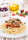 Spaghetti with tomatoes on wooden table Stock Image