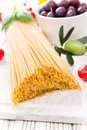 Spaghetti with tomatoes on wooden table Royalty Free Stock Images