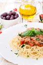 Spaghetti with tomatoes on wooden table Stock Photography