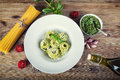 Spaghetti.Top of view italian food spaghetti with basil pesto tomatoes and olive oil Royalty Free Stock Photo
