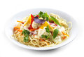 Spaghetti with vegetables on white plate Stock Photo