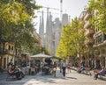 SPAIN, BARCELONA - OCT 21, 2018 : Cafe restaurant Cozy street in Barcelona city People walking Sagrada Familia Architecture