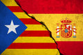 Spain flag on broken brick wall and half catalan flag, vote referendum for catalonia independence exit national crisis separatism Royalty Free Stock Photo
