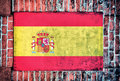 Spain flag on the old bricks wall Stock Image