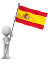 Spain flag spanish held up by a little man against white background waving and hoisted in light wind Royalty Free Stock Image