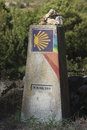 Spain galicia camino de santiago milestone rainbow painted at the primitivo Royalty Free Stock Photo