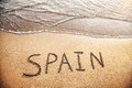 Spain title on the sand beach near ocean Royalty Free Stock Photography