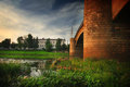 Span bridge green grass near water river Stock Photography
