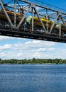 The span of the railroad bridge with freight train on it across dnieper in kyiv passing across Stock Photo