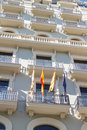 Spanish catalan and european flags on exterior of an modernist building from barcelona Stock Photography
