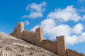 Spanish city wall albarracin teruel spain medieval stone walls on the hill against a blue sky province of aragon Royalty Free Stock Photography