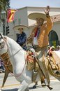 Spanish cowboy on horseback during opening day parade down State Street, Santa Barbara, CA, Old Spanish Days Fiesta, August 3-7, 2 Royalty Free Stock Photo