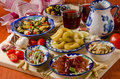 Spanish cuisine assorted tapas on ceramic plates assortment of including serrano ham marinated olives mussels in sauce and others Stock Image