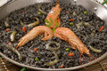 Spanish cuisine. Black rice. Arroz negro. Stock Photo