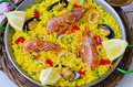 Spanish cuisine paella in a pan view from above taken in daylight Stock Photos