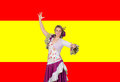 Spanish culture girl dressed in traditional costume andalusian dancing on a over red and yellow background Royalty Free Stock Images