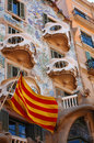 Spanish flag and casa battlo the barcelona Stock Photos