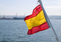 Spanish flag waving in a boat on a sunny day Royalty Free Stock Photo