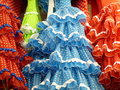 Spanish flamenco dresses row of colourful on sale in shop in madrid spain Royalty Free Stock Photos