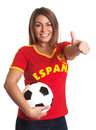 Spanish girl with football showing thumb up attractive is happy about the national team and on an isolated white background Royalty Free Stock Photos