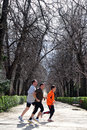 Spanish men jogging in Retiro Park in Madrid Spain Royalty Free Stock Photo