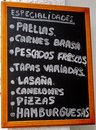 Spanish menu board outside bar Stock Photo