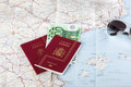 Spanish passports with european union currency and glasses on a Royalty Free Stock Photo