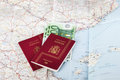 Spanish passports with european union currency on a map backgrou Royalty Free Stock Photo