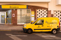 Spanish post office and delivery van for the national postal service correos parked on the street outside the building in a small Stock Photo