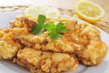 Spanish rape rebozado battered and fried angler closeup of a plate with Royalty Free Stock Photo
