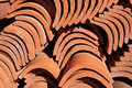 Spanish roof tiles red curved are piled in a heap Royalty Free Stock Photography