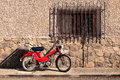 Spanish rural village motorcycle and home detail at evening Royalty Free Stock Photo