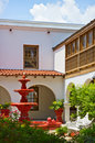 Spanish style patio with red fountain Royalty Free Stock Images