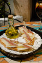 Spanish tapa on a sunny andalusian bar terrace table Royalty Free Stock Image