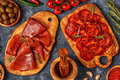 Spanish tapas with chorizo, jamon, picnic table. Royalty Free Stock Photo