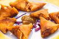 Spanish tapas fried filled pastry triangles plate with golden and sauce Royalty Free Stock Photo