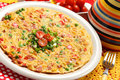 Spanish tortilla with green peas and tomatoes Stock Images