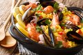 Spanish traditional cuisine: hot paella with seafood shrimps, mu Royalty Free Stock Photo