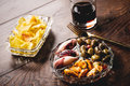 Spanish vermouth traditional appetizer with drink canned food and chips Royalty Free Stock Photography