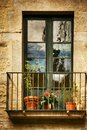 Spanish Windows with Balcony, Decorated With Fresh Flowers, Vintage Style Royalty Free Stock Photo