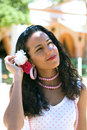Spanish Woman in Feria Dress adjusts hair Royalty Free Stock Photo