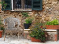 Spanish yard a old and traditional with terracotta pots wooden and rush chair over a stone wall house Stock Photography