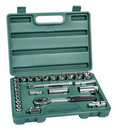 Spanner and bits kit in green toolbox Royalty Free Stock Photo