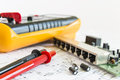 Spare filter capacitors to switch of networks after measured by multimeter Stock Photo