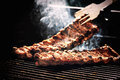 Spare ribs cooking on barbecue grill for summer outdoor party. F Royalty Free Stock Photo